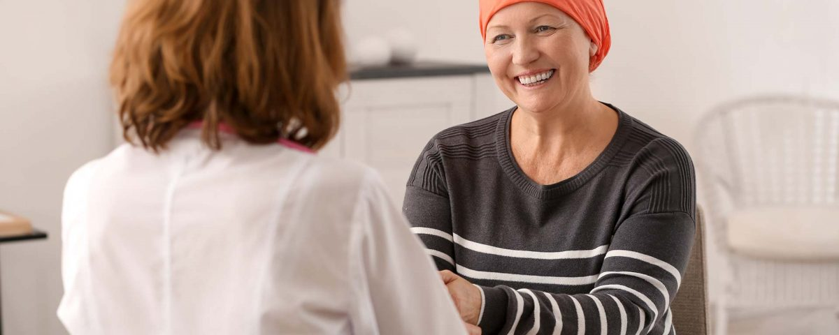 A chemotherapy patient consults her doctor.