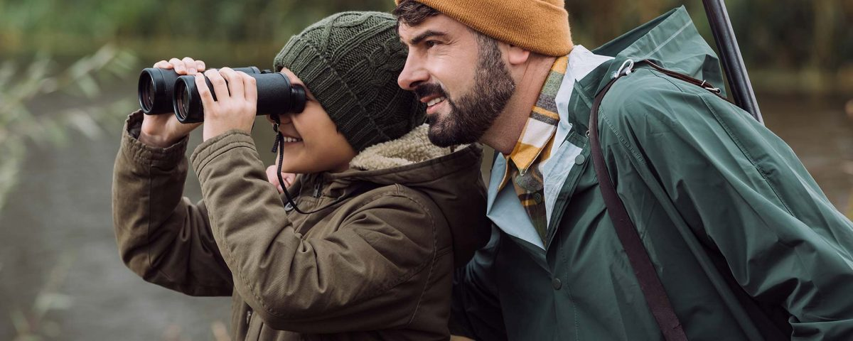 A father and son scout their hunting location.